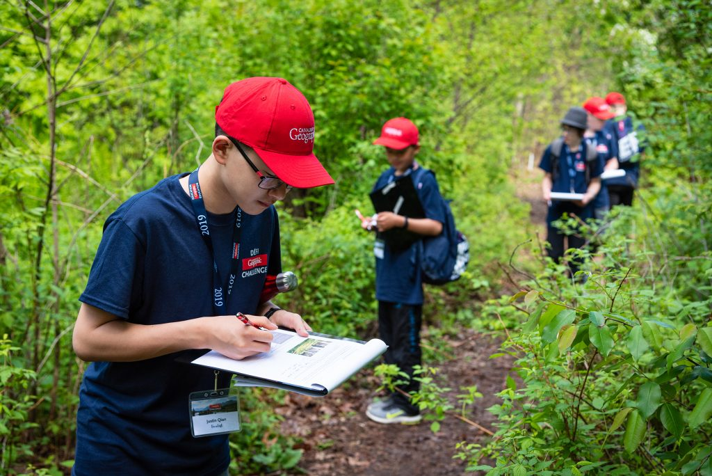 Students taking notes in forest setting